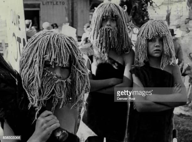 Cavemen Posed A Question Banner of their float read 'You've Come a Long Way Baby' Next one asked 'And What have you Got' Marching were Wade and...
