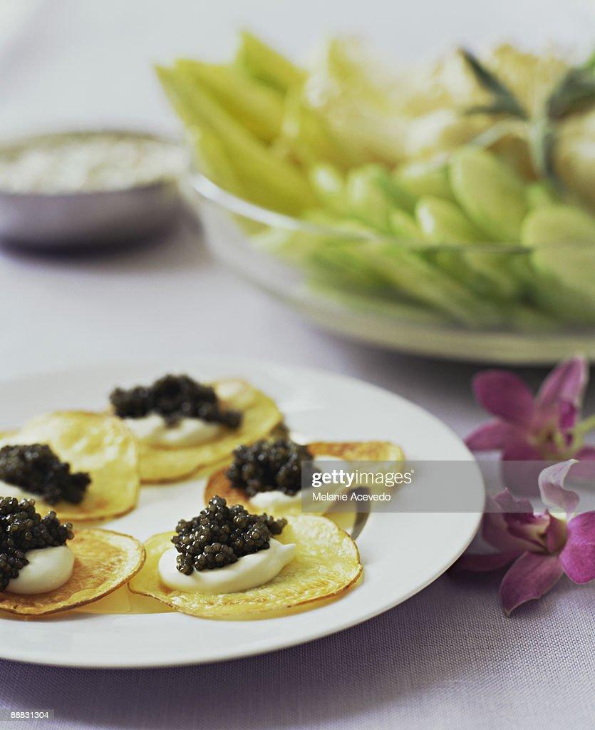 caviar and creme fraiche on potato crisps appetizer stock photo getty images. Black Bedroom Furniture Sets. Home Design Ideas