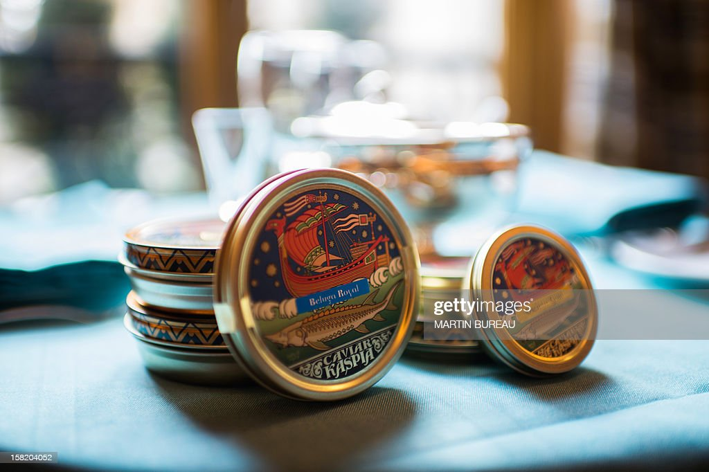 Caviar boxes are displayed on a table of the restaurant of Kaspia Caviar, on December 11, 2012 in Paris.