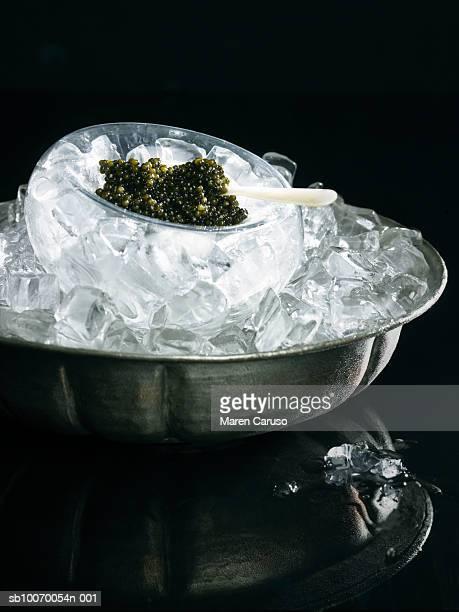Caviar in bowl of ice, studio shot