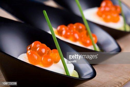 Caviar on quail egg and avocado mousse : Stock Photo