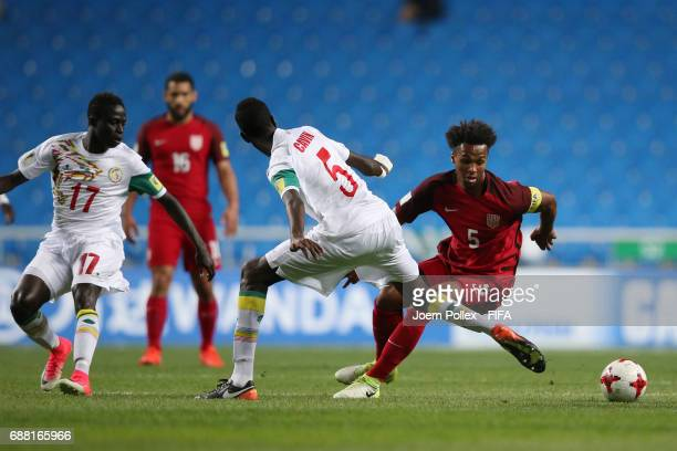 Cavin Diagne of Senegal and Erik PalmerBrown of USA compete for the ball during the FIFA U20 World Cup Korea Republic 2017 group F match between...