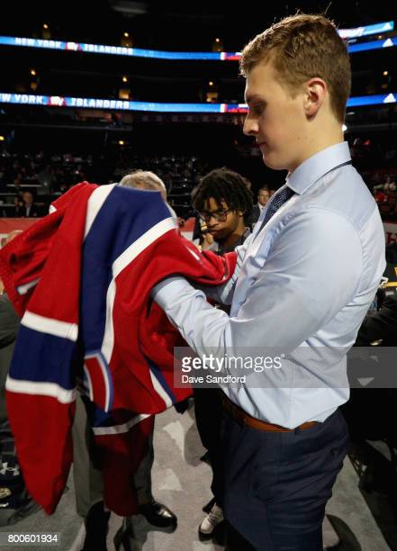 Cayden Primeau puts on his jersey after being selected 199th overall by the Montreal Canadiens during the 2017 NHL Draft at United Center on June 24...