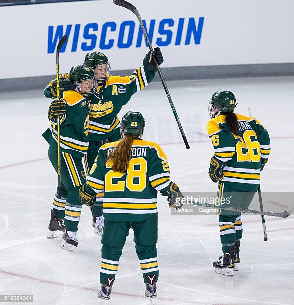 Cayley Mercer of the Clarkson Golden Knights celebrates her goal with teammate Erin Ambrose Kelly Mariani and Josiane Pozzebon against the Boston...