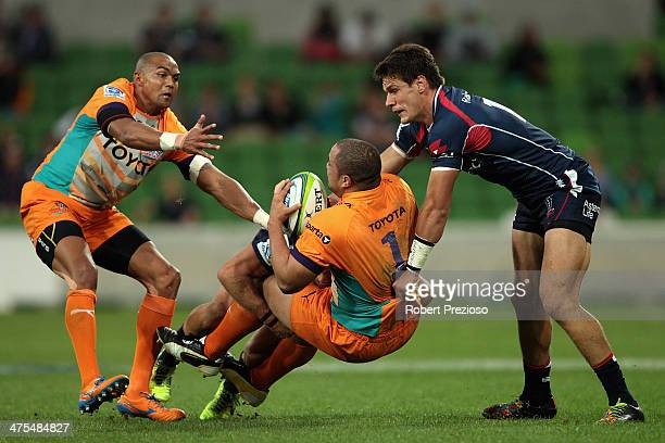 Caylib Oosthuizen of the Cheetahs is tackled by Mitch Inman of the Rebels during the round three Super Rugby match between the Melbourne Rebels and...