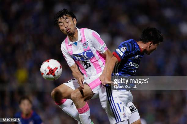 Cayman Togashi and Takeshi Aoki of Sagan Tosu compete for the ball during the JLeague J1 match between Yokohama FMarinos and Sagan Tosu at Nippatsu...