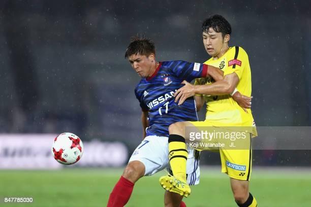 Cayman Togashi of Yokohama FMarinos controls the ball under pressure of Yuta Nakayama of Kashiwa Reysol during the JLeague J1 match between Yokohama...