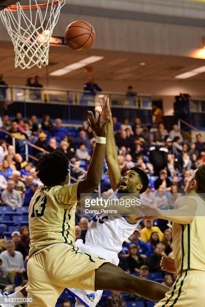 Cazmon Hayes of the Delaware Fightin Blue Hens shoots the ball over Nathan Knight of the William Mary Tribe during the first half at the Bob...