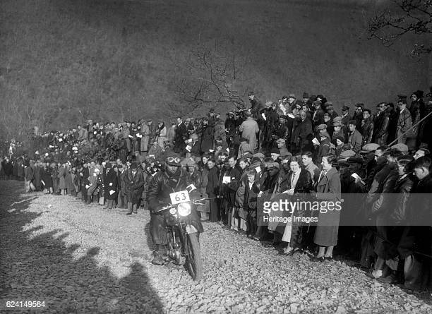 498 cc Levis of AJ Hicks competing in the MCC Lands End Trial Beggars Roost Devon 1936 Artist Bill BrunellLevis 498 cc Event Entry No 63 Rider Hicks...