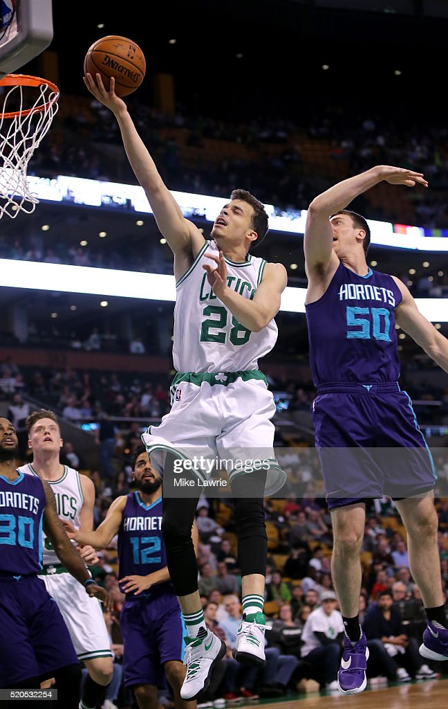 cc28 drives to the basket against Tyler Hansbrough #50 of the Charlotte Hornets in the fourth quarter at TD Garden on April 11, 2016 in Boston, Massachusetts.