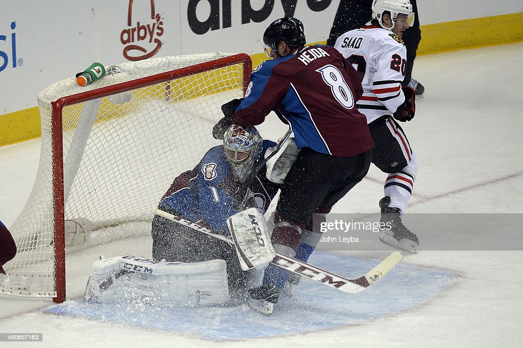 CColorado Avalanche defenseman Jan Hejda (8) puts the breaks on before running in to Colorado Avalanche goalie Semyon Varlamov (1) during the second period against the Chicago Blackhawks November 19, 2013 at Pepsi Center.