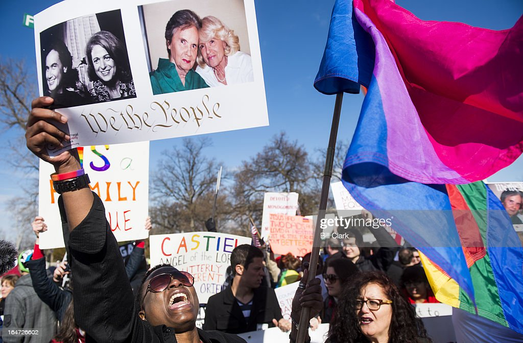 Cd Kirven, left, of Dallas, Texas, leads chants for marriage equality supporters as they rally in front of the Supreme Court before oral arguments in the United States v. Windsor case, which will test the constitutionality of the Defense of Marriage Act on March 27, 2013. The Defense of Marriage Act, or DOMA, is a 1996 federal statute defining marriage as the union of one man and one woman.