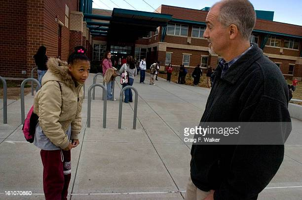 cd06sars_DPS_CFW Dean of Students Brian Dale talks with 8thgrader Shay Cooper at the end of the school day at Bruce Randolph Middle School in Denver...