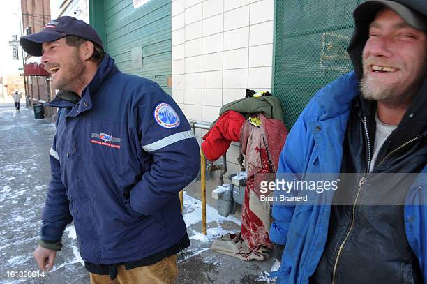 cd15cold_bb_8 Companions Duane Moschner left and Patrick Birk had lunch at the Denver rescue mission Monday after sleeping outside in sub zero...