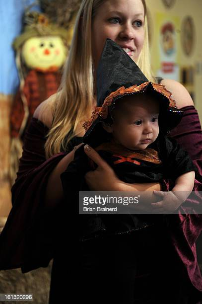cd26bugaboo_bb_ 3 Chelsea Lucas holds 3monthold daughter Violet at the Butterfly Pavilion's annual Halloween spectacular Bug A Boo The event had a...