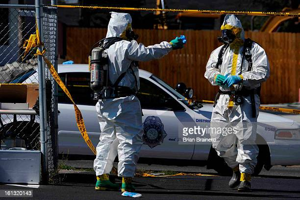 cd28meth_bb_ Denver Police Dept detectives test for toxic meth lab chemicals after stopping a robbery suspect on the 600 blk S Federal where they...