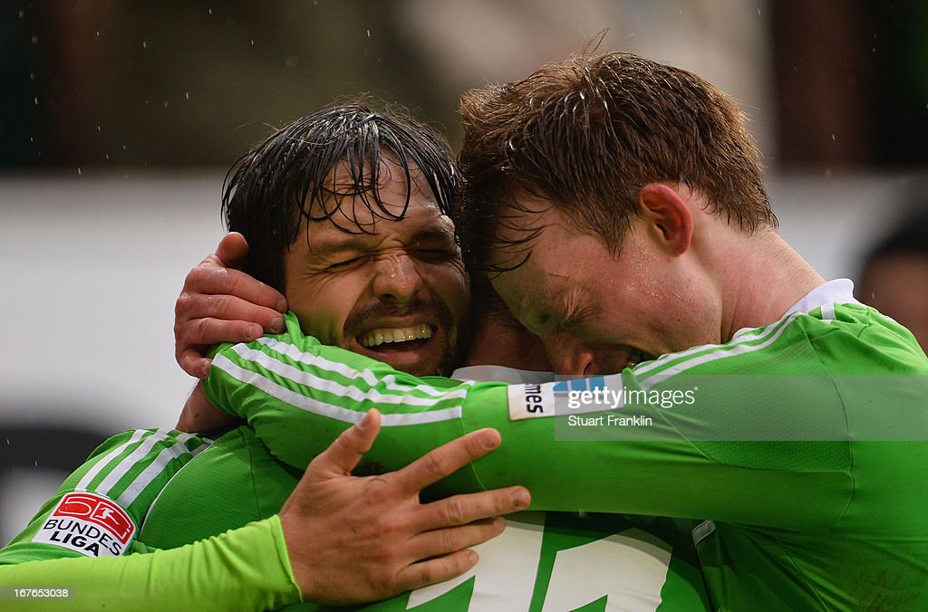 cDiego of Wolfsburg celebrates scoring his goal with <a gi-track='captionPersonalityLinkClicked' href=/galleries/search?phrase=Maximilian+Arnold&family=editorial&specificpeople=7166144 ng-click='$event.stopPropagation()'>Maximilian Arnold</a> and Ivicai Olic during the Bundesliga match between VfL Wolfsburg and VfL Borussia Moenchengladbach at Volkswagen Arena on April 27, 2013 in Wolfsburg, Germany.