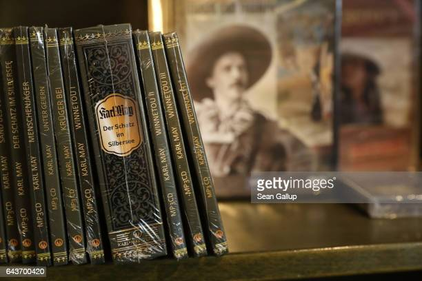 CDs and DVDs of audio books and movies based on the adventure novels of 19thcentury German writer Karl May stand on display for sale at museum shop...