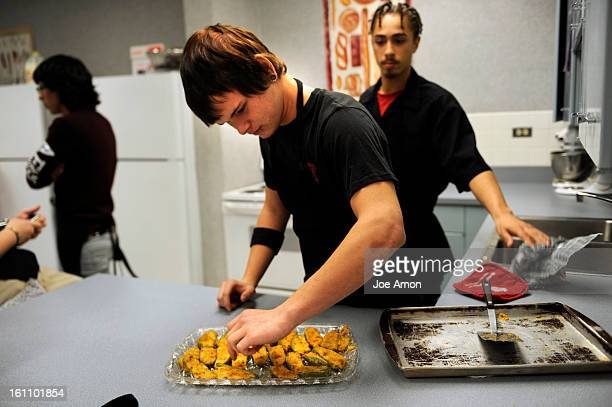 cdXXhomeec04a Northglenn High School junior Jericol Duensing adjusts the display of the jalapeno poppers he and his group made with the help of Ryan...
