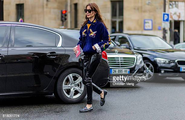 ce Sukan is wearing a velvet jacket and black leather pants and Gucci loafers outside Miu Miu during the Paris Fashion Week Womenswear Fall/Winter...