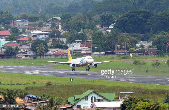 A Cebu pacific air passenger plane lands at the airport after flights to and from the city since last week were cancelled due to the standoff between...