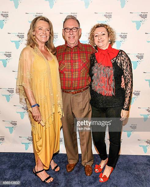 Cece and Dr Ronald Nudelman with The Samburu Projects Board Chair Linda Hooper arrive at the Samburu Splash Bash Event on September 27 2014 in Santa...