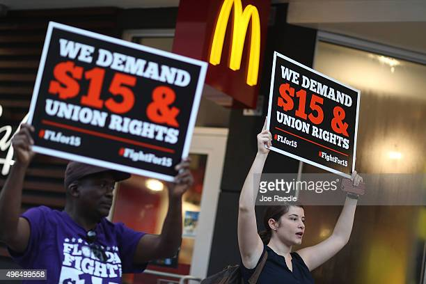 Cecelia O'Brien joins other workers to protest outside a McDonald's restaurant on November 10 2015 in Miami Florida The protesters are demanding...