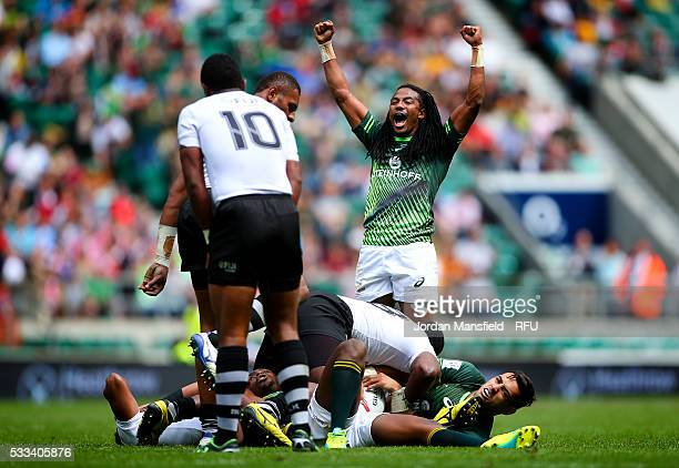 Cecil Afrika of South Africa celebrates at the final whistle after their Cup semifinal victory against Figi during day two of the HSBC London Sevens...