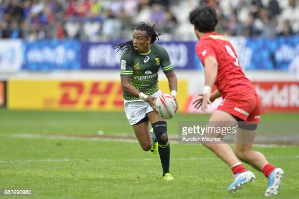 Cecil Afrika of South Africa runs with ball during the HSBC rugby sevens match between South Africa and Canada on May 13 2017 in Paris France