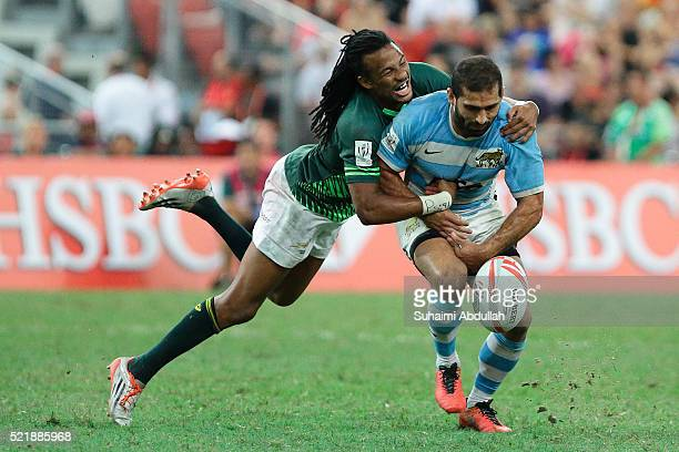 Cecil Afrika of South Africa tackles Gaston Revol of Argentina in the 2016 Singapore Sevens Cup 3rd and 4th placing between Argentina and South...