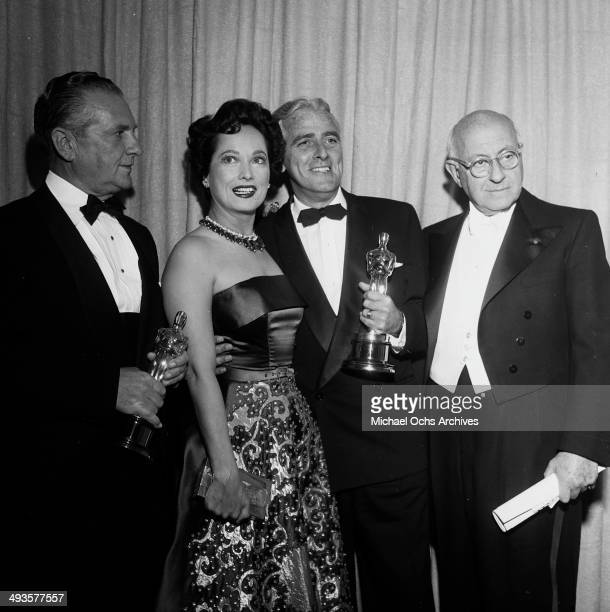 Cecil B DeMille poses with Academy Awards winners in Los Angeles California