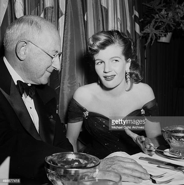 Cecil B DeMille with Corinne Calvert attends an Golden Globes awards party in Los Angeles California