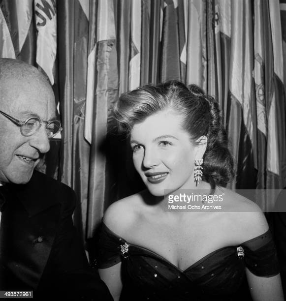 Cecil B DeMille with Corinne Calvert attends the Golden Globes awards in Los Angeles California