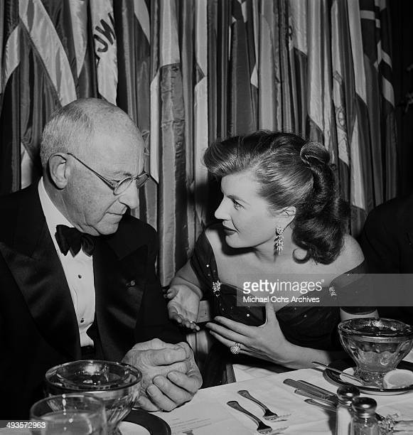 Cecil B DeMille with Corinne Calvert attends the Golden Globes awards party in Los Angeles California