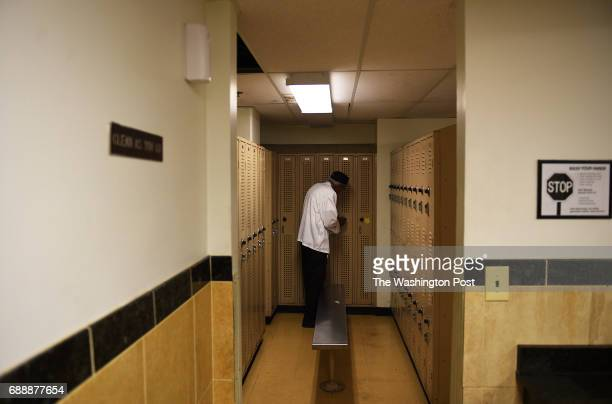 Cecil Exum keeps his personal belongings in a locker in the basement at the Marriott Crystal Gateway hotel in Arlington VA May 3 2017 Exum who...