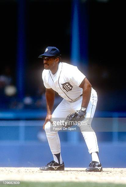 Cecil Fielder of the Detroit Tigers is down and ready to make a play on the ball during an Major League Baseball game circa 1991 at Tiger Stadium in...