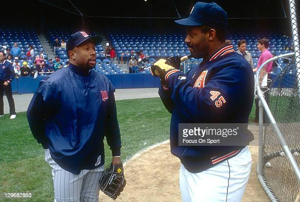 Cecil Fielder of the Detroit Tigers talks with Kirby Puckett of the Minnesota Twins during batting practice before an Major League Baseball game...
