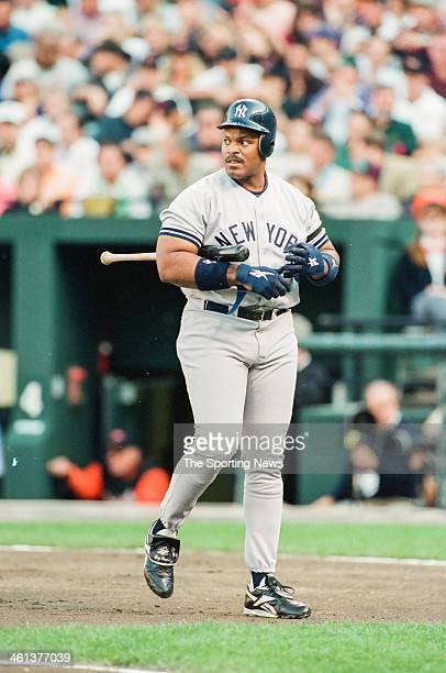 Cecil Fielder of the New York Yankees bats during Game Five of the American League Championship Series against the Baltimore Orioles on October 13...