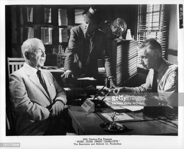 Cecil Kellaway William Campbell and Wesley Addy talk at the Sheriff's office in a scene from the film 'HushHush Sweet Charlotte' 1964