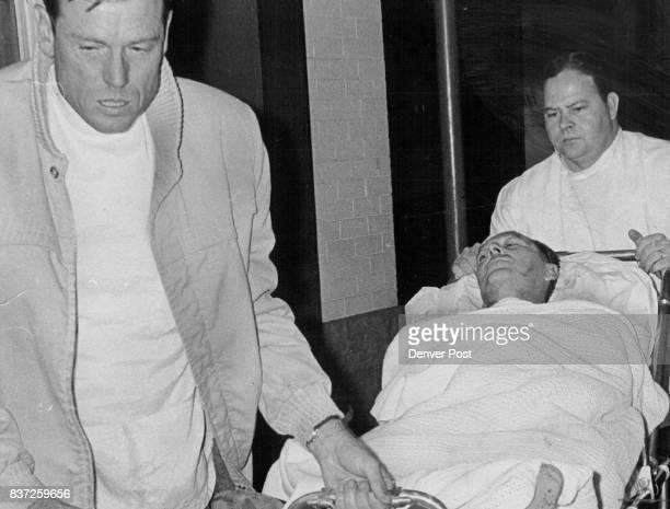 Cecil L Phillips Is Wheeled Into Denver General Hospital Bob Streeter ambulance driver right and Kenneth Edwards attendant move stretcher Credit...