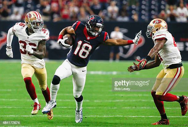 Cecil Shorts of the Houston Texans gives Antoine Bethea of the San Francisco 49ers a stiff arm as Mylan Hicks looks to assist as Shorts runs for a 58...
