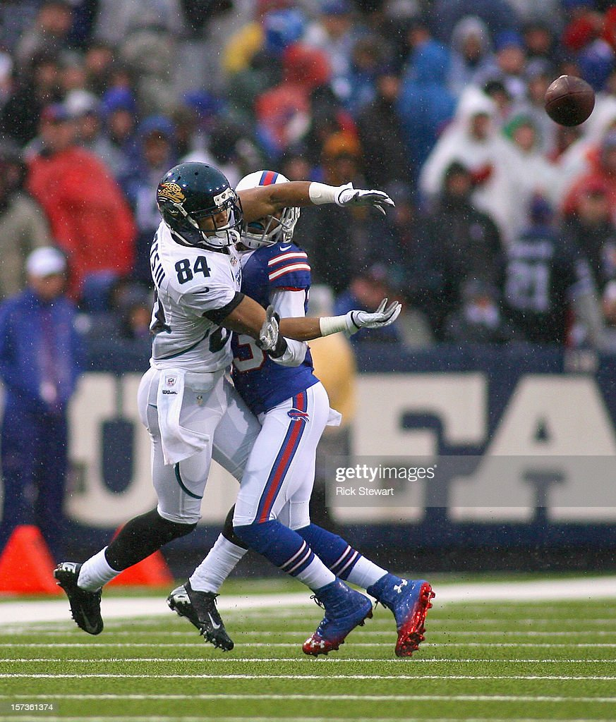 Cecil Shorts #84 of the Jacksonville Jaguars can't make a catch against <a gi-track='captionPersonalityLinkClicked' href=/galleries/search?phrase=Ron+Brooks&family=editorial&specificpeople=597392 ng-click='$event.stopPropagation()'>Ron Brooks</a> #33 of the Buffalo Bills at Ralph Wilson Stadium on December 2, 2012 in Orchard Park, New York. Brooks was called for interference on the play.