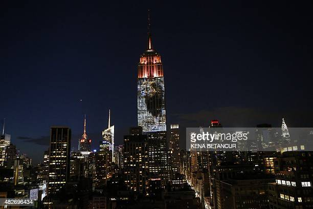 Cecil the lion from Zimbabwe that was killed by an American Dentist is projected on the Empire State Building in the 'Projecting Change on the Empire...