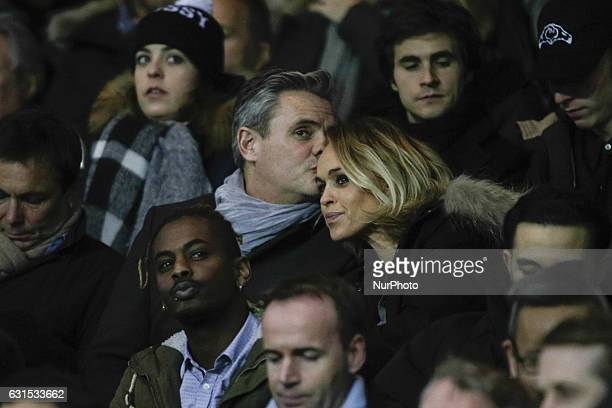 Cecile de Menibus' boyfriend Thierry kisses her on the forehead during the French League Cup quarterfinal football match between Paris SaintGermain...