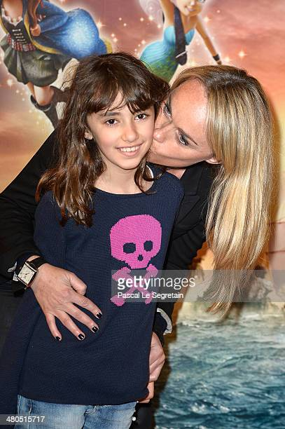 Cecile de Menibus poses with Shayan during 'Clochette et la Fee Pirate' Premiere at Gaumont Champs Elysees on March 25 2014 in Paris France