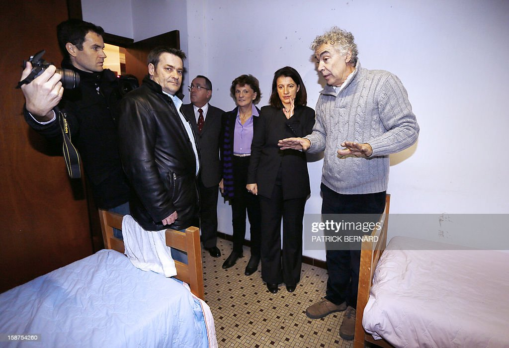 Cecile Duflot (2nd R), French Minister for Equality of Territories and Housing, stands alongside Michele Delaunay (3rd R), French Junior Minister for the Elderly and Disabled, as they meet with representatives and staff members of the Emmaus association, a non-profit which works with the homeless, and visit an emergency housing shelter in Bordeaux, on December 27, 2012. Facing criticism from some housing rights organizations, Cecile Duflot stated that procedures to open up new spaces for housing by requisitioning buildings that have been left empty and unused for a long time by their owners are hindered by the slowness of the judicial procedures they entail, but vowed to move forward with the initiative.