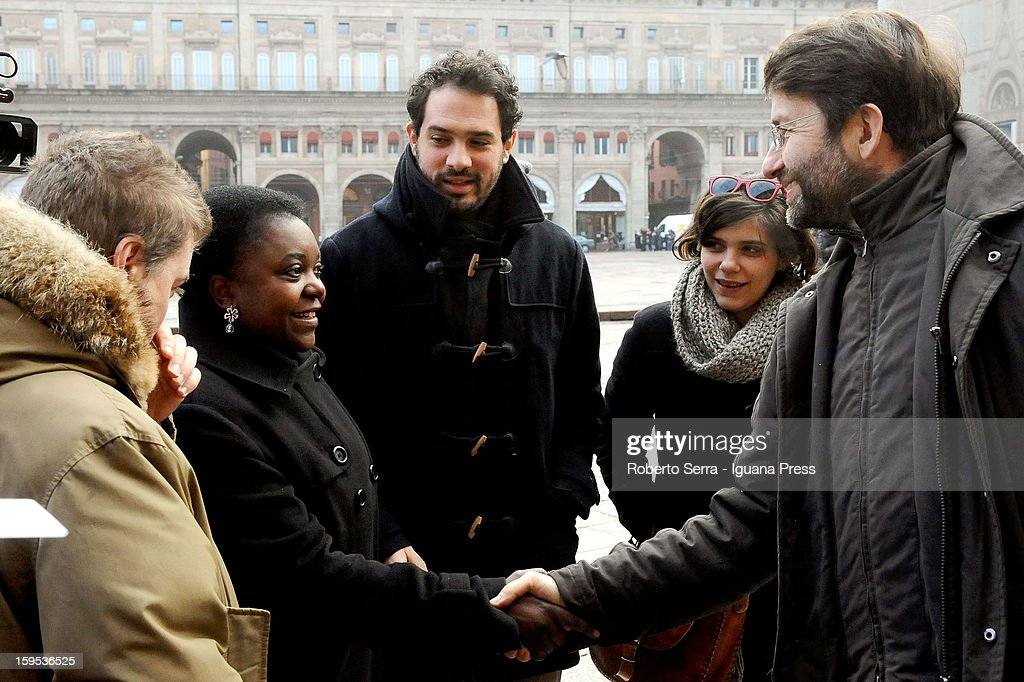 Cecile Kyenge Kashetu (L) and <a gi-track='captionPersonalityLinkClicked' href=/galleries/search?phrase=Dario+Franceschini&family=editorial&specificpeople=4851356 ng-click='$event.stopPropagation()'>Dario Franceschini</a> (R), PD's candidate at Italian Parliament in the next political elections, shake hands in front of Farnese Chapel of Palazzo D'Accursio on January 15, 2013 in Bologna, Italy. The elections of a new Italian Parliament will take place on February 24.