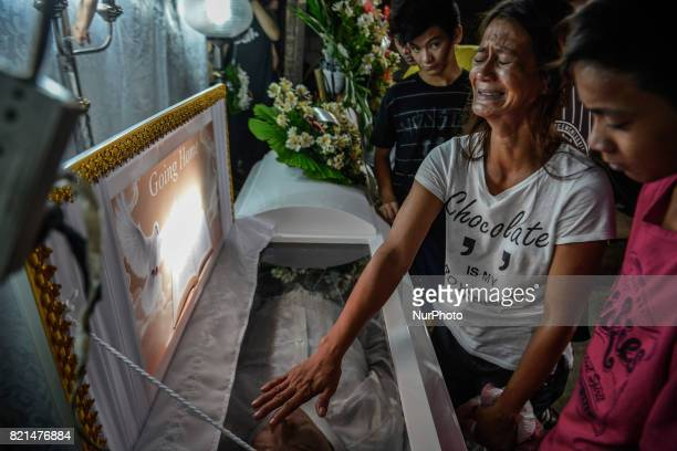 Cecile Santos mourns during the funeral wake of her Marvin De Los Santos who was killed by unknown assailants in Quezon city Metro Manila Philippines...