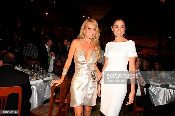 Cecilia Bolocco and Jessica Tapia pose during the awards ceremony GQ Men of the Year 2012 at La Huaca Pucllana on November 23 2012 in Lima Peru