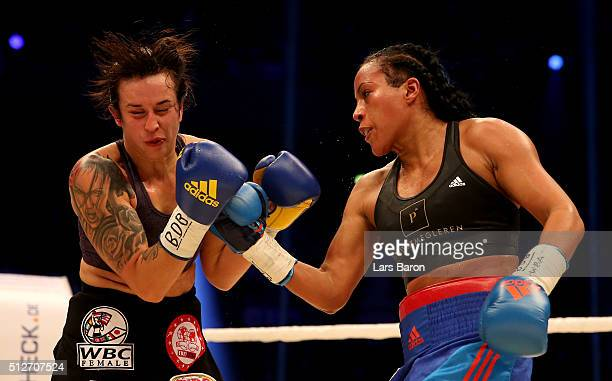 Cecilia Braekhus punshes Chris Namus during their Welterweight World Championship fight prior to the IBO Cruiserweight World Championship fight...